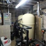 Swimming pool backwash discharge plant